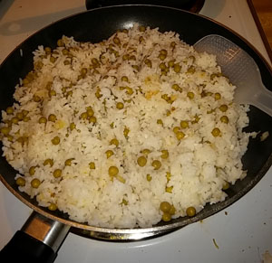 Mix in rice and peas